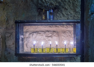 Traditional Menorah (Hanukkah Lamp) with olive oil candles, in the Jewish quarter, Jerusalem Old City, Israel