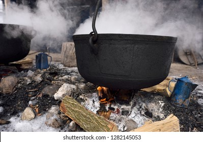 Traditional method of evaporating sap in cast iron cauldron to produce maple syrup Kortright Centre for Conservation,  Woodbridge, Ontario, Canada - March 1, 2015
