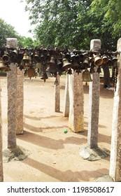 Traditional method to hang the bells in front of god for vow of nerthikadan in perillamaram dharma munishwarar temple at vediyarendal, manamadurai, sivagangai district, Tamilnadu, India-10/08/2018.