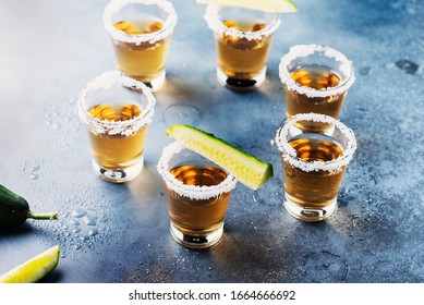 Traditional mexical tequila with salt, pepper and cucmber, selective focus image