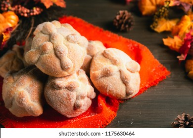 "Traditional mexican bread of the dead ""pan de muerto"" on a wooden background"