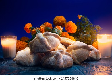 "Traditional mexican bread of the dead ""pan de muerto"" on a blue background"