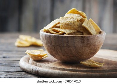 Traditional mexican chips on the wooden table, selective focus
