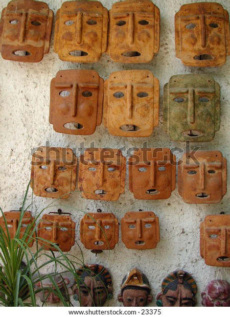 Traditional Mexican clay mask souvenirs for the garden.