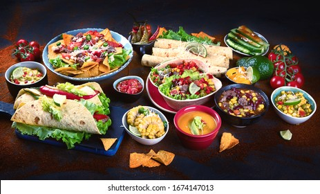 Traditional Mexican food mix on dark background.
