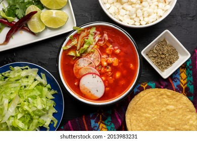 Traditional mexican food. Red pozole with chicken on dark background