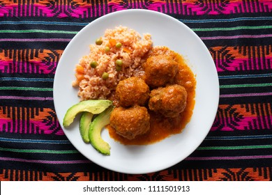Traditional mexican meatballs with red rice