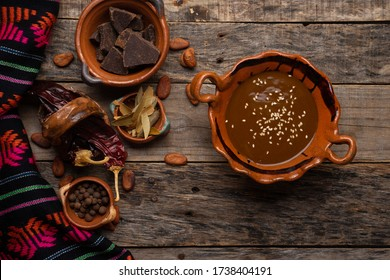 Traditional mexican mole sauce on wooden background