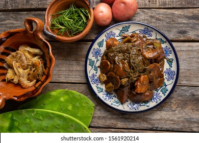 """Traditional mexican rosemary with mole sauce and dried shrimps also called """"romeritos"""" on wooden background"""