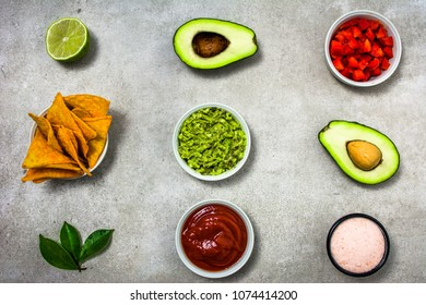 Traditional mexican sauce - guacamole dip with avocado, tortilla chips snack on table, party food for sharing