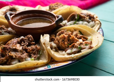 Traditional mexican slow cooked lamb tacos also called barbacoa on turquoise background