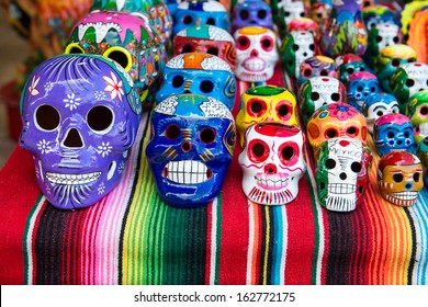 Traditional Mexican souvenir skulls on the market. Travel background for Mexico, Latin America.
