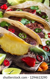 Traditional mexican street food - beef tongue tacos with ananas salsa and guacamole