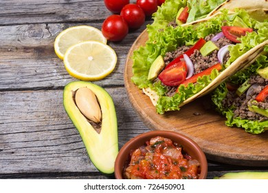 Traditional mexican tacos with beef , tomato and avocado