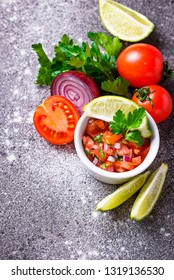Traditional mexican tomato salsa sauce on wooden background