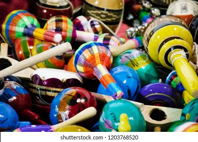 Traditional Mexican toys, maracas and guitars made of wood. Handcraft and sale inside street markets. Ready to make a Fiesta or celebrate the Cinco de Mayo