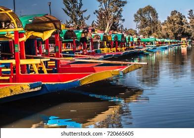 Traditional Mexican trajinera boats in Xochimilco channels