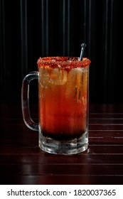 Traditional Michelada with pepper on top and sauce