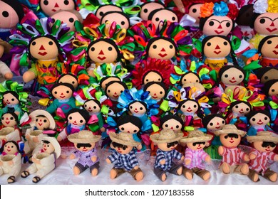 Traditional Michoacan rag doll souvenir for sale in a market of Leon, Mexico. One of the most representative and traditional Mexican toys with indigenous-like dress, braids & colorful ribbons.
