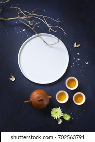 Traditional mid autumn festival celebration tea time image. Big bright moon form by a white plate, flying insects form by pumpkin seeds. Flat lay conceptual text space image.