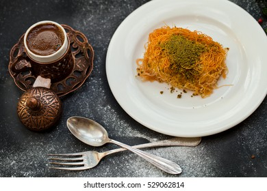 Traditional Middle Eastern dessert baklava with pistachio nuts and Turkish Coffee