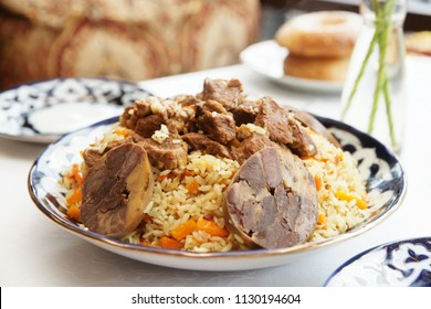 Traditional Middle Eastern pilaf rice served in deep blue clay plate