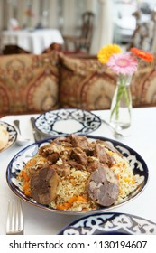 Traditional Middle Eastern pilaf rice with lamb served on restaurant table