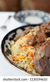 Traditional Middle Eastern pilaf rice in plate on restaurant table, close-up