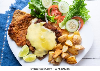 Traditional milanese beef and french fries potatoes