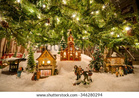 traditional miniature christmas village beneath tree - Miniature Christmas Town Decorations