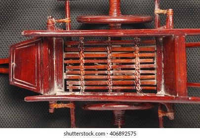 The traditional miniature wooden model of thai style cart represent the agricultural model and farm equipment concept related idea.