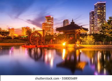 traditional and modern architecture of seoul city after sunset, central park in songdo International business district, Incheon South Korea.
