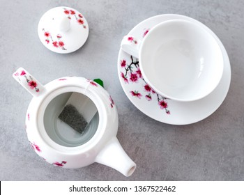 Traditional modern and elegant china tea service with tea bag on the grey table