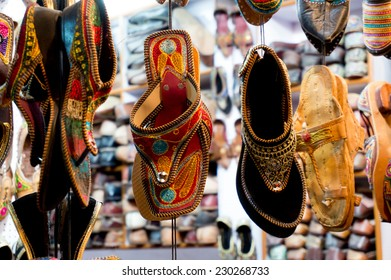 Traditional mojari shoes (Juttis) of various designs on display. These are shoes made from leather and decorated with various elements for royalty