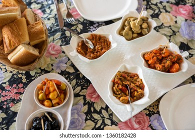 Traditional Moroccan appetizer with spiced olives, carrots, beans and okra