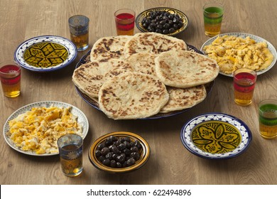 Traditional Moroccan  breakfast with pancakes,eggs,olives,olive oil and mint tea