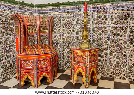 Traditional Moroccan Chair And Table On A Zellige Background