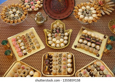 Traditional Moroccan dessert trays with coconut, chocolate, and honey cookies displayed at Middle Eastern parties and Jewish Sephardic events