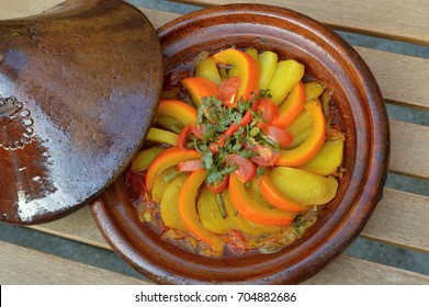 Traditional moroccan tagine with pumpkin, potatoes, tomatoes and more