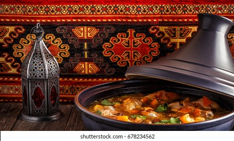 Traditional moroccan tajine of chicken with salted lemons, olives, selective focus.
