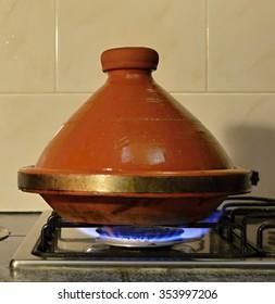 Traditional Moroccan tajine pot on gas cooker