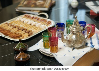 Traditional Moroccan tea with Ramadan cookies on festive silver tray.