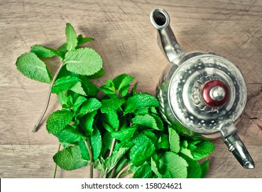 Traditional moroccan teapot with mint ready for tea