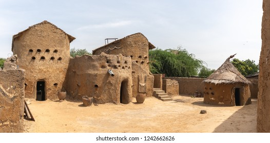 Traditional mud built houses in Gaoui, Chad N'Djamena. Old ancient houses, located in Sahel desert and Sahara. Hot weather in desert climate on the Chari river.