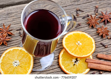 Traditional mulled wine with spices on table