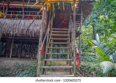 Traditional Murut longhouse in Mari Mari Cultural Village, Sabah, Malaysia. Staircase in the tribe's home