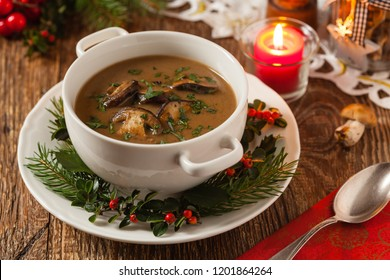 Traditional mushroom soup, made from porcini mushrooms. Christmas decoration. Front view.