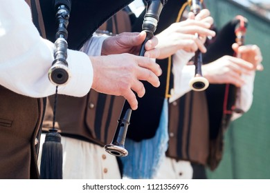 traditional musicians in Galicia with wooden and leather boots and linen costume , Spain