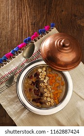 Traditional muslim dessert, Noah's pudding, ashura on a wooden table, top view, ashure, asure