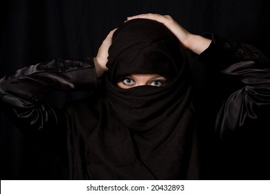 traditional muslim headress with only eyes showing